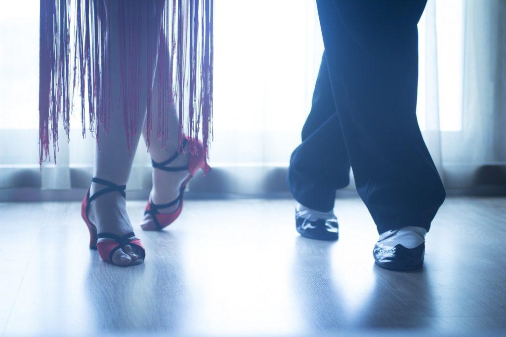 Ballroom dancers' feet dancing side-by-side