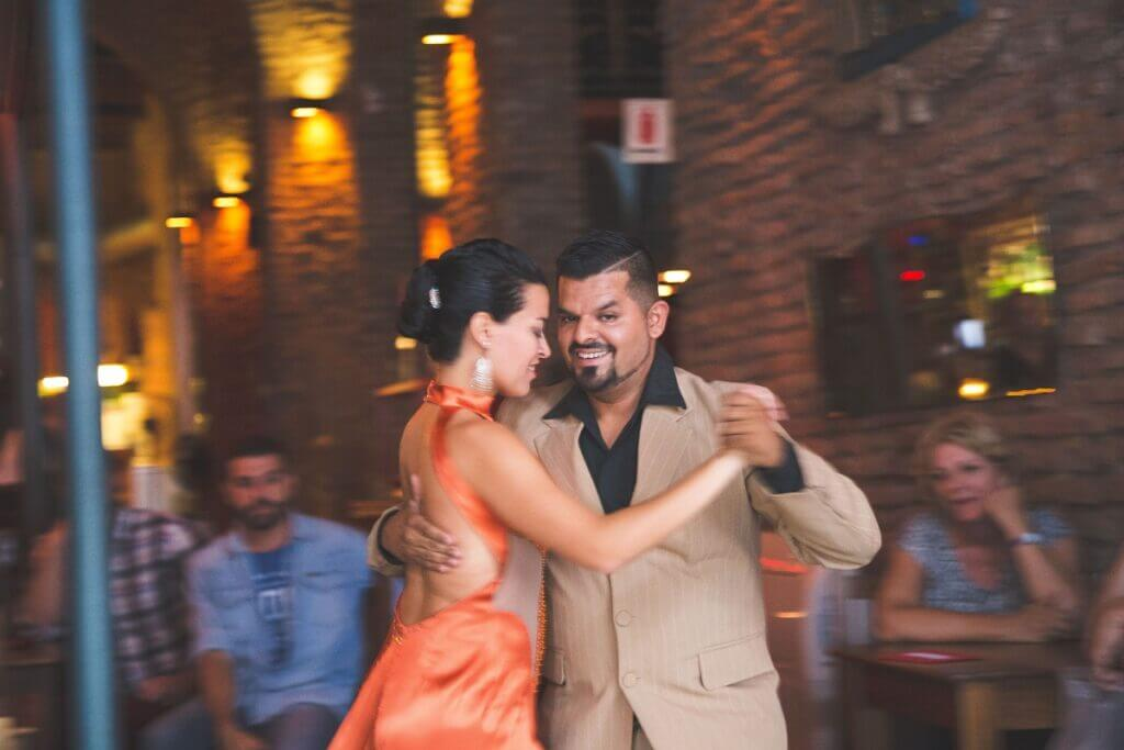 Couple dance salsa in a bar