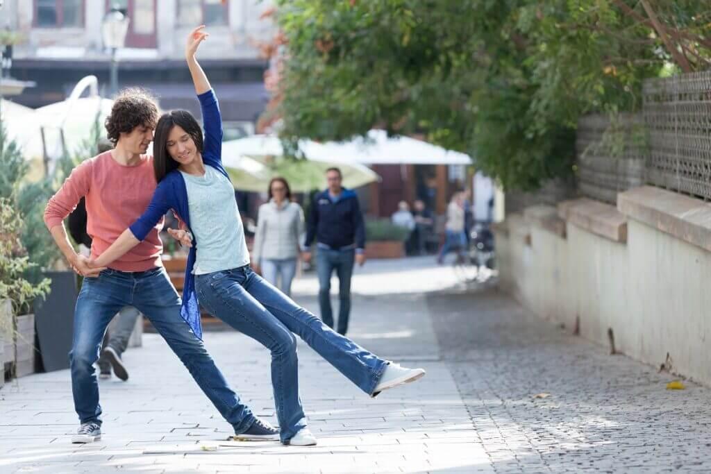 Couple dance West Coast Swing on street