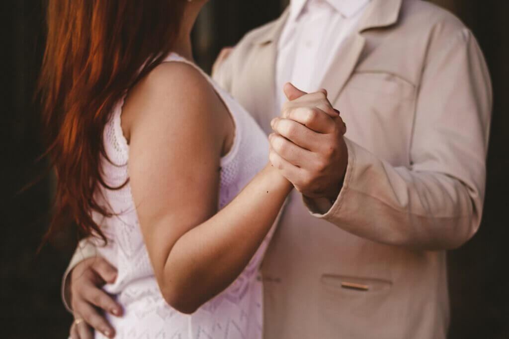 Couple in partner hold ready to dance West Coast Swing