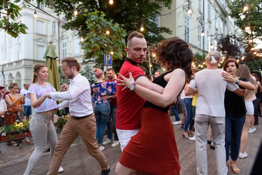 Couple do a dip in a salsa party