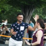 Man and woman dance Dominican bachata in park