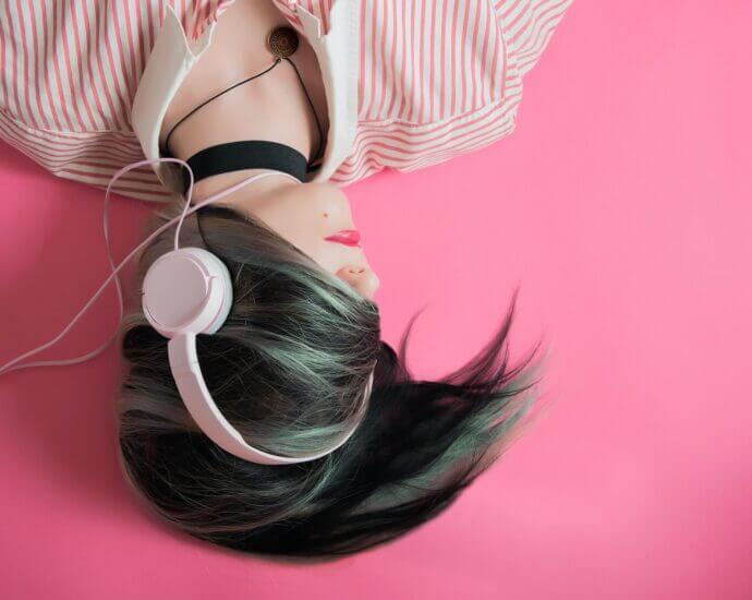 Woman listens to music on headphones