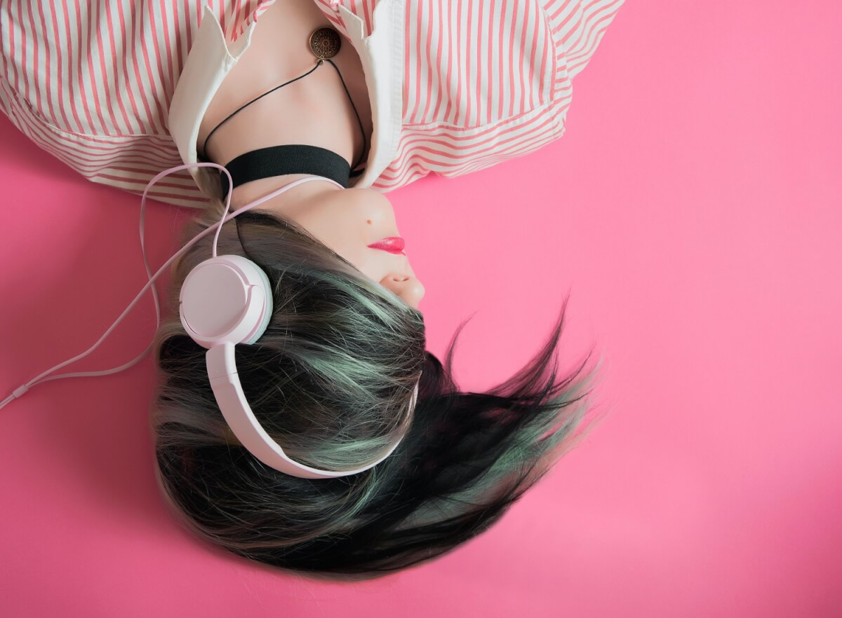 Woman listens to music on headphones