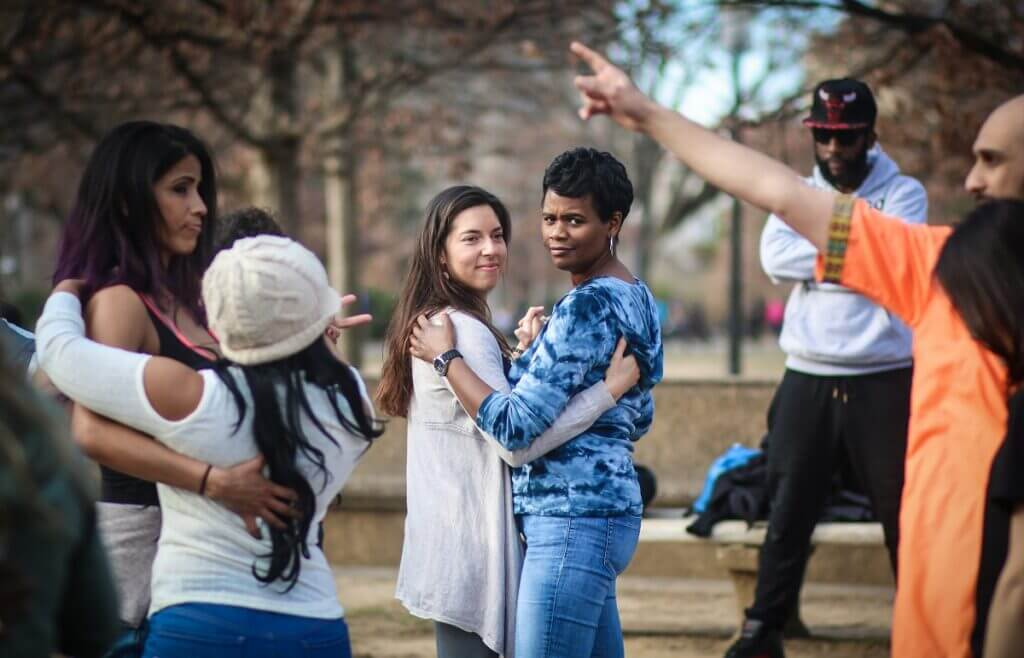4 women dance bachata in outdoor class