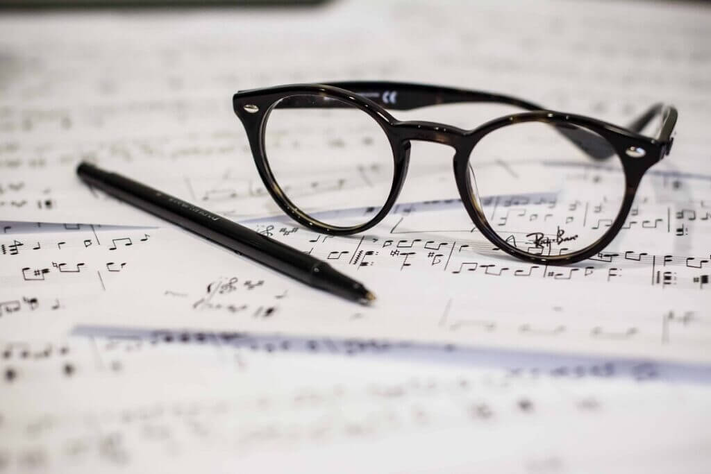 West Coast Swing sheet music with glasses and pen
