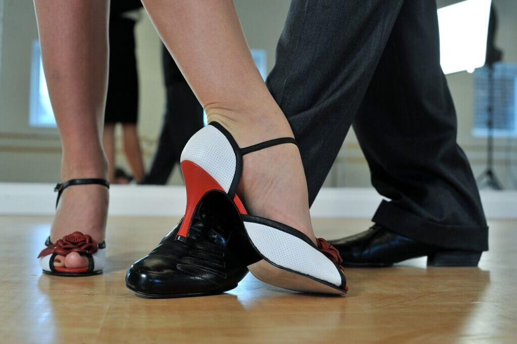 Feet of couple dancing Argentine tango