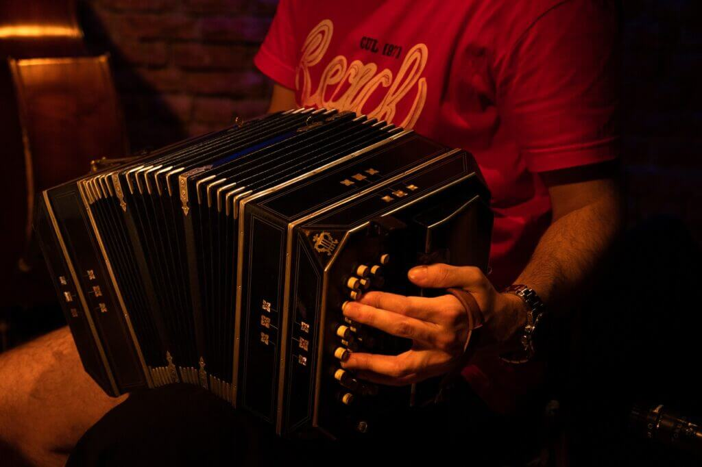 Man plays tango with the bandoneon