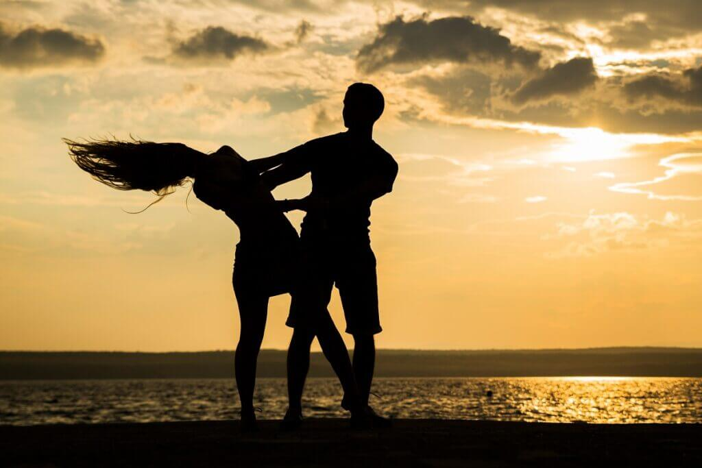 Couple dance Brazilian zouk on the beach