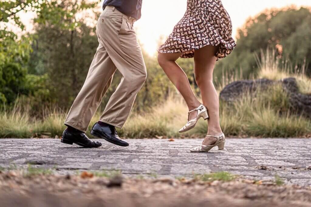 Couple dance swing outside in swing shoes