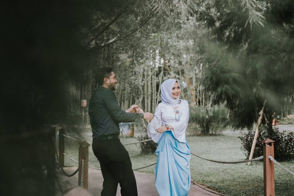 Couple prepares to dance swing in a forest