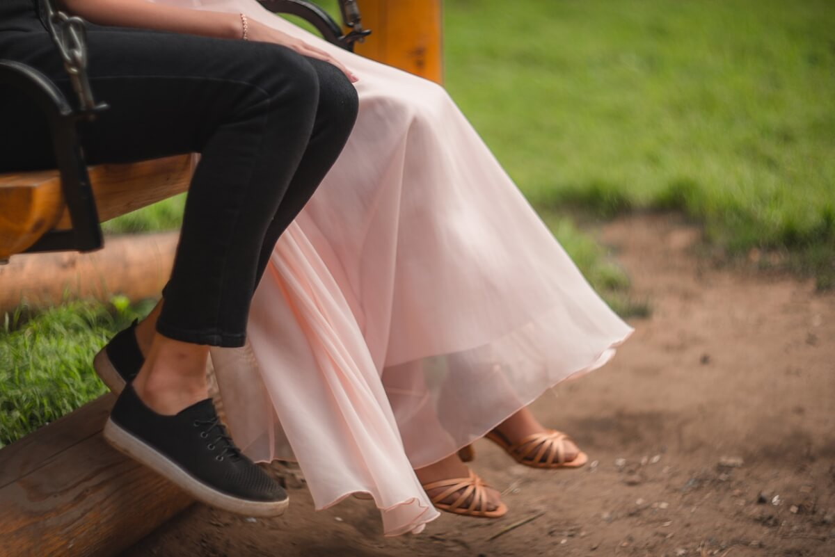 Legs of two swing dancers wearing street and dance shoes