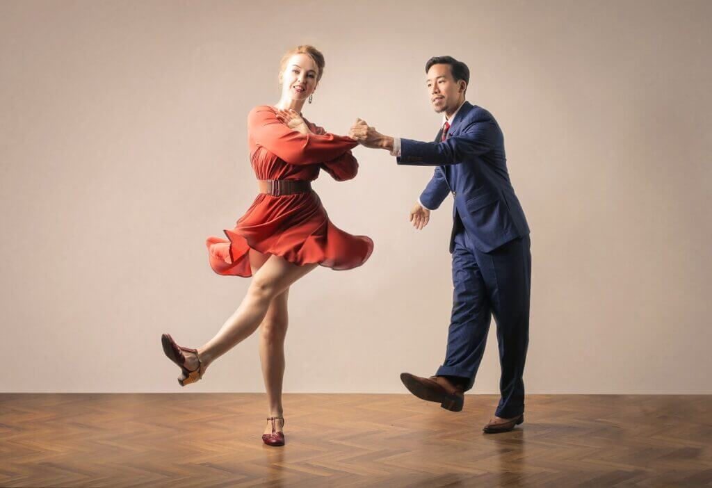 Couple dance swing in ballroom and dance shoes