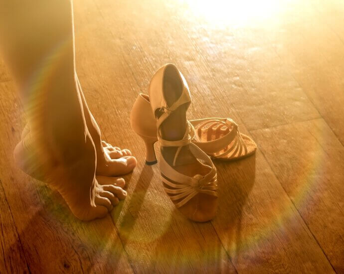 Woman's legs and her dance shoes