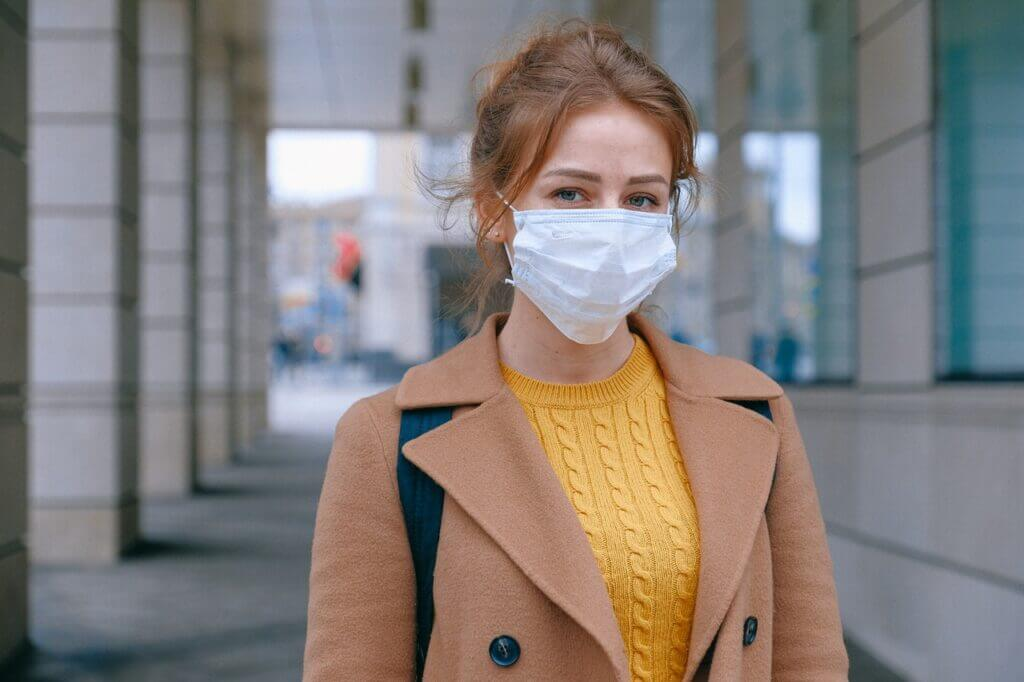 Woman wearing face mask on way to a dance class