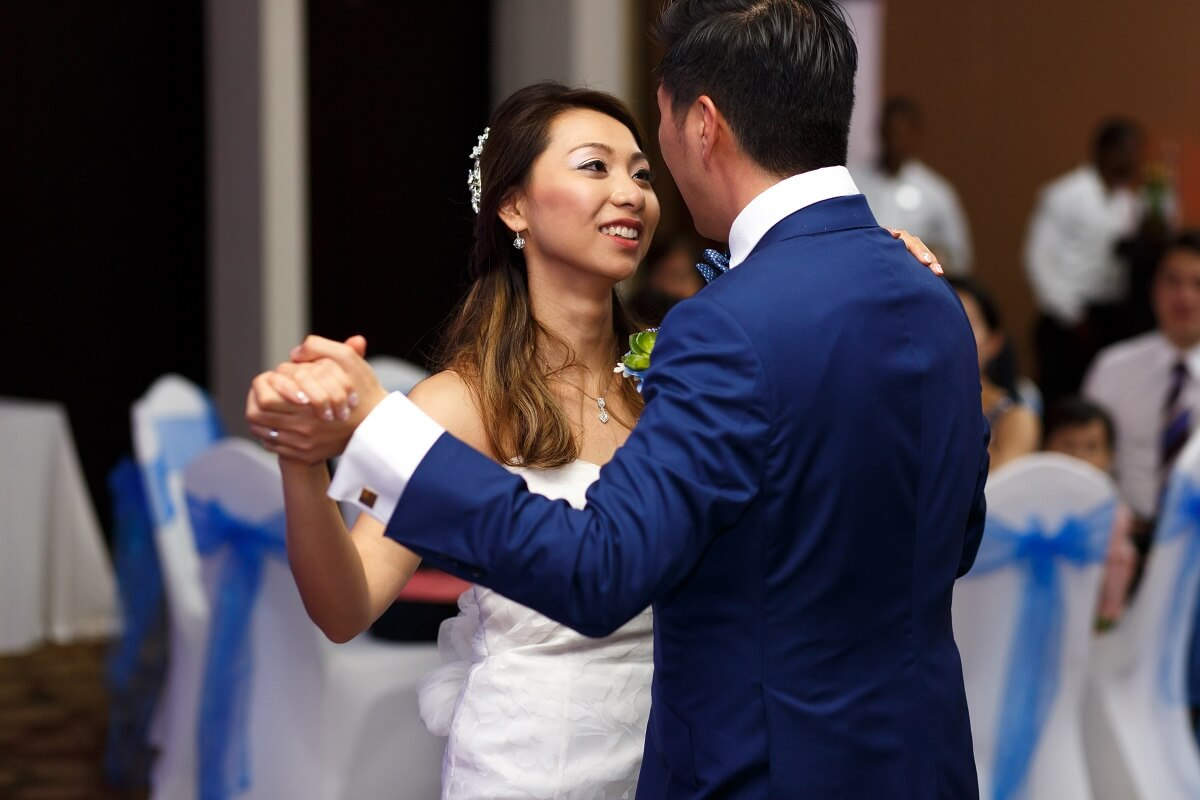Couple dance to a romantic waltz song at their wedding