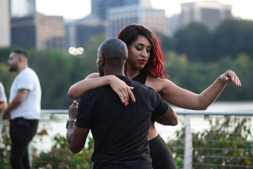 Couple does arm styling while dancing bachata