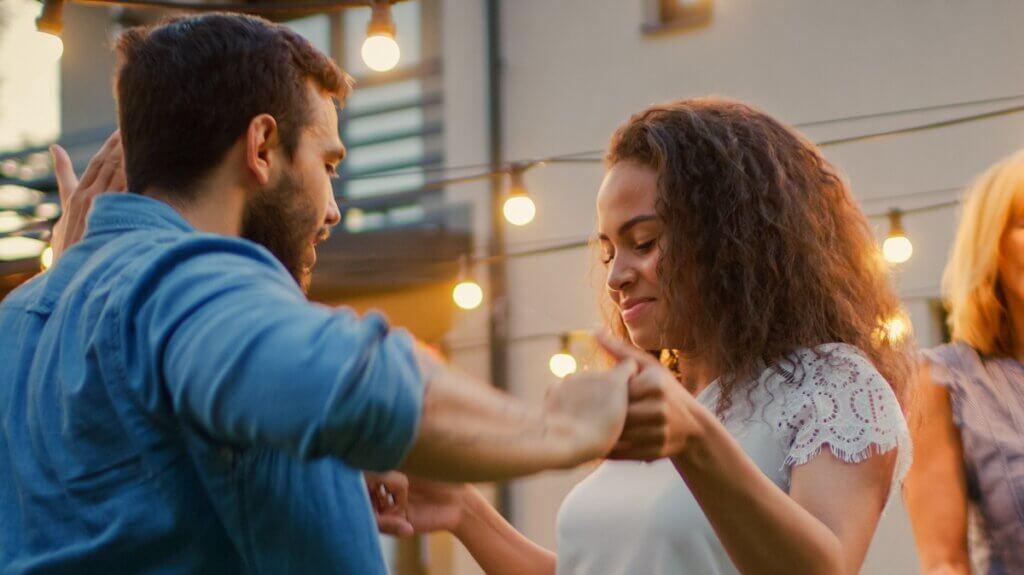 Woman leads salsa basic step while man follows